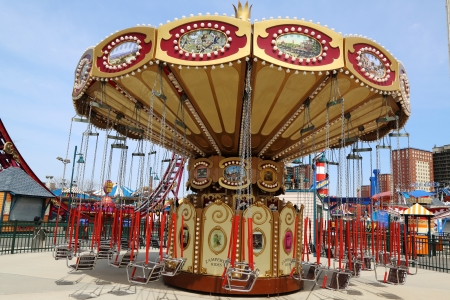 trapeze: BROOKLYN, NEW YORK - APRIL 9: Lynns Trapeze  swing carousel on April 9, 2013 in Coney Island  Luna Park. Coney Island Luna Park was destroyed by fire in 1944, then reopened in 2010. Editorial