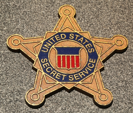 undercover agent: BROOKLYN,NEW YORK - MARCH 9:US Secret Service emblem on fallen officers memorial on March 9, 2013 in Brooklyn. 71 officers were killed when World Trade Center buildings collapsed on September 11, 2001