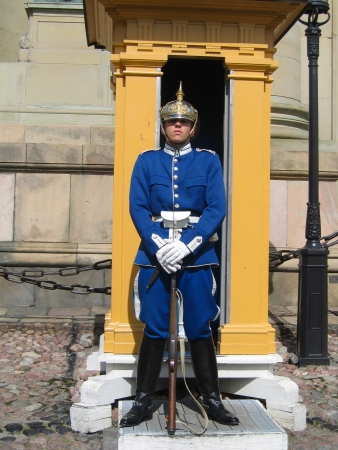 STOCKHOLM, SWEDEN - AUGUST 8: Royal Guard protecting  Royal Palace in Stockholm on August 8, 2005. The Life Guards is a combined cavalry infantry regiment of the Swedish Army founded in 1521 Editorial
