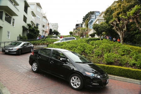 SAN FRANCISCO, CA - MARCH 28: Cars moving downhill on Lombard Street in San Francisco on March 28, 2013.  It is famous for having a steep, one-block section that consists of eight tight hairpin turns