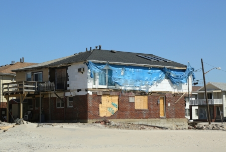 fema: FAR ROCKAWAY, NY - APRIL 25: Destroyed beach houses in devastated area six months after Hurricane Sandy on April 25, 2013 in Far Rockaway, NY  Editorial