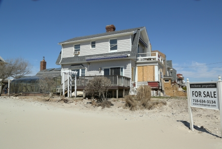 FAR ROCKAWAY, NY - APRIL 25:Destroyed beach property for sale in devastated area six months after Hurricane Sandy  on April 25, 2013 in Far Rockaway, NY