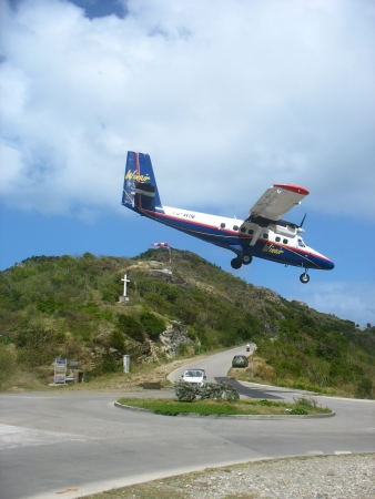 shortest: ST. BARTHS, FRENCH WEST INDIES - JANUARY 21:-Dramatic Winair plane landing at St Barth airport on January 23, 2006. At 2,133 ft its runway is one of the shortest in the world. Editorial