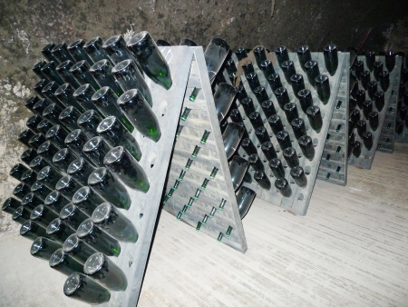 NAPA VALLEY, CA - MARCH 26: Champagne bottles stored in Schramsberg cellar during riddling on March 26, 2013. Schramsberg is the first U.S. wine to match the style and quality of the best French Champagnes