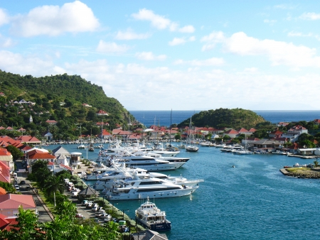 ST BARTS, FRENCH WEST INDIES - JANUARY 16:Aerial view at Gustavia Harbor with mega yachts on January 16, 2006 at St Barts. The island is popular tourist destination during the winter holiday season