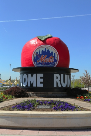 home run: FLUSHING, NY - MAY 2: The Famous Shea Stadium Home Run Apple on Mets Plaza in the front of Citi Field, home of major league baseball team the New York Mets on May 2, 2013 in Flushing, NY. Editorial