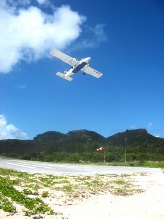 shortest: ST. BARTHS, FRENCH WEST INDIES - JANUARY 21:Small plane taking off from St  Barths airport on January 23, 2006. At 2,133 ft its runway is one of the shortest in the world.