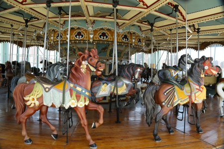 merry go round: Horses on a traditional fairground carousel