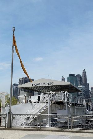 BROOKLYN, NEW YORK - MAY 7: Bargemusic moored in Brooklyn just under the Brooklyn Bridge on May 7, 2013. New York City�s floating concert hall presents great music up to five days a week