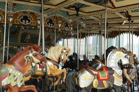 Horses on a traditional fairground carousel photo