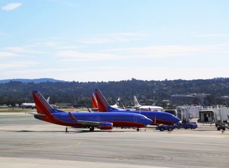 SAN FRANCISCO, CA - MARCH 29: Southwest aircrafts ready to take off on March 29, 2013 at San Francisco airport. Southwest Airlines  is a major U.S. airline and the world Stock Photo - 19652480