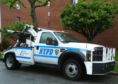 special service agent: BROOKLYN, NY- MAY 19: NYPD tow truck in Brooklyn, NY on May 19, 2013. The New York Police Department, established in 1845, is the largest police force in USA