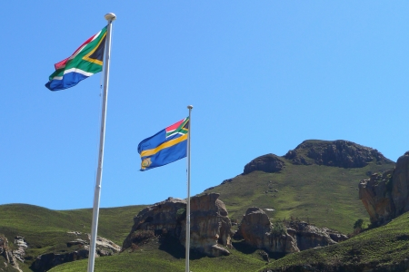 enclave: South African flags at Sani Pass border control between South Africa and Lesotho  The Kingdom of Lesotho is a landlocked country and enclave
