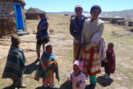 landlocked: SANI PASS, LESOTHO - SEPTEMBER 19, 2009: Unidentified family at Sani Pass, Lesotho on September 19, 2009 at altitude of 2 874m. The Kingdom of Lesotho, is a landlocked country and enclave