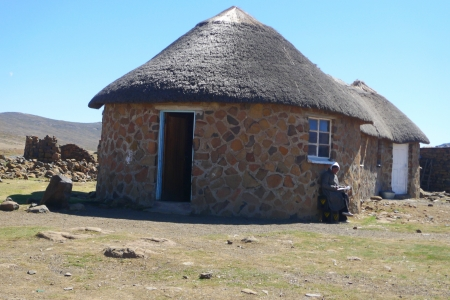 landlocked:  SANI PASS, LESOTHO - SEPTEMBER 19, 2009: Traditional style of housing in Lesotho at Sani Pass on September 19, 2009 at altitude of 2 874m. The Kingdom of Lesotho, is a landlocked country and enclave