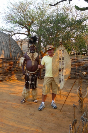 ZULULAND, SOUTH AFRICA - SEPTEMBER 14: Zulu Chief posing with tourist in Shakaland Zulu Village on September 14, 2009. A unique cultural center built on the set of movies Shaka Zulu and John Ross Sajtókép
