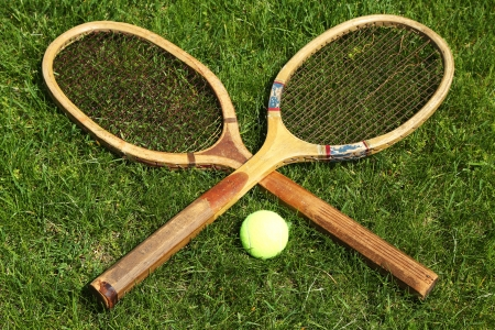 Old tennis rackets on grass court