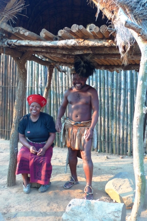 ZULULAND, SOUTH AFRICA - SEPTEMBER 14: Zulu warrior with his wife in Shakaland Zulu Village on September 14, 2009. A unique cultural center built on the set of movies Shaka Zulu and John Ross