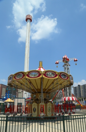 trapeze: BROOKLYN, NEW YORK - MAY 30: Lynn s Trapeze swing carousel on May 30, 2013 in Coney Island Luna Park. Coney Island Luna Park was destroyed by fire in 1944, then reopened in 2010 Editorial