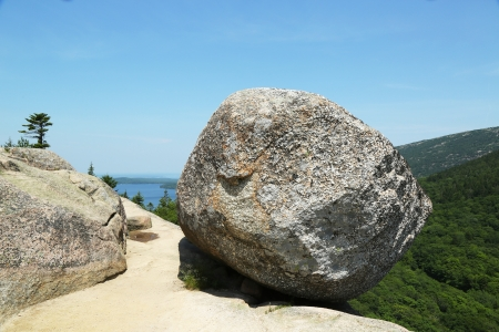 precarious: Bubble Rock on top of the South Bubble Mountain and Jordan Pond at Acadia National Park, Maine, USA