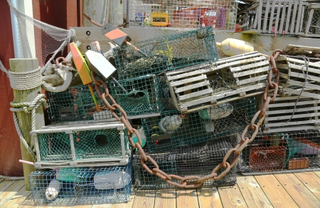 lobster pots: Lobster traps and lobster buoys at the  dock in Bar Harbor, Maine