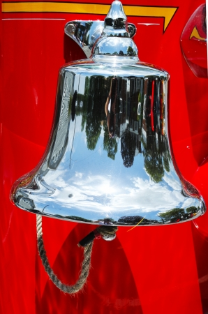 Alarm bell on old fire truck Stockfoto