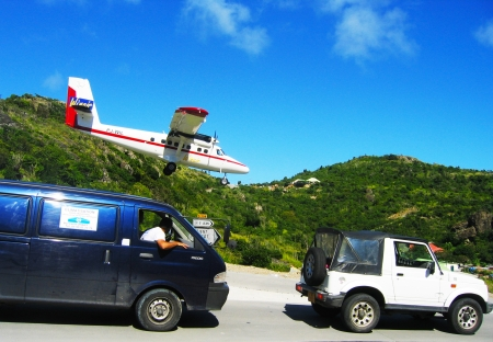 ST. BARTS, FRENCH WEST INDIES - JANUARY 15: Dramatic Winair plane landing at St Barts airport on January 15, 2004. At 2,133 ft its runway is one of the shortest in the world