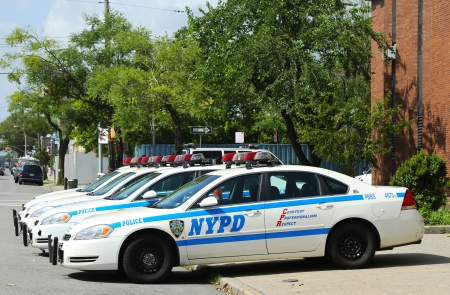 BROOKLYN, NY- JULY 14: Police cars in the front of NYPD 61st Precinct in Brooklyn , NY on July 14, 2013. The New York Police Department, established in 1845, is the largest police force in USA