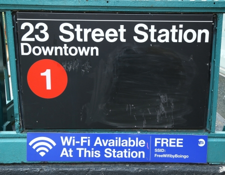 subway entrance: NEW YORK CITY - JUNE 27: Subway entrance at 23rd Street in NYC on June 17,  2013. Station has free Wi-Fi available. Owned by the NYC Transit Authority, the subway system has 469 stations in operation