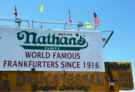 BROOKLYN, NEW YORK - MAY 27 : The Nathan s original restaurant sign on May 27, 2013 at Coney Island, New York. The original Nathan s still exists on the same site that it did in 1916.  Stock Photo - 20910133
