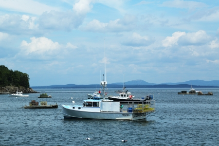 lobster boat: BAR HARBOR, MAINE - JULY 6: Lobster boats at Frenchman Bay near Bar Harbor, Maine on July,6, 2013. Bar Harbor is a famous summer colony in the Down East region of Maine famous for lobster fishing
