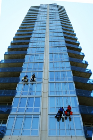 Four window washers on skyscraper