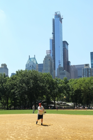 NEW YORK CITY - JULY 18:Softball teams playing at Heckscher Ballfields in Central Park on July 18, 2013.There are 26 softball and baseball fields open to the public in Central Park