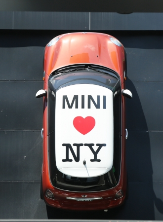 NEW YORK CITY - July 18: Mini Cooper dealership in Manhattan on July 18, 2013.  In 1999 the Mini was voted the second most influential car of the 20th century, behind the Ford Model T