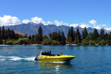 QUEENSTOWN,NZ - JANUARY 26: High speed jet boat on the Lake Wakatipu on January 26, 2009 in Queenstown, New Zealand. Queenstown is one of the most popular summer resort in NZ