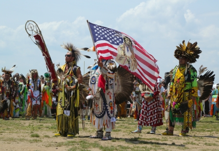 BROOKLYN, NEW YORK - JUNE 2: The Eagle Staff leads the Grand Entry at he NYC Pow Wow in Brooklyn on June 2, 2013. A pow-wow is a gathering and Heritage Celebration of North America s Native people