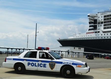 NEW YORK CITY - JULY 27: Port Authority Police New York New Jersey providing security for Queen Mary 2 cruise ship docked at Brooklyn Cruise Terminal on July 27, 2013.