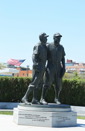 BROOKLYN, NY - JULY 30: Jackie Robinson and Pee Wee Reese Statue in Brooklyn in front of MCU ballpark on July 30, 2013. 42 is an upcoming 2013 Hollywood film about baseball player Jackie Robinson  Stock Photo - 21184269