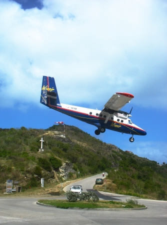 shortest: ST  BARTS, FRENCH WEST INDIES - JANUARY 21 Dramatic Winair plane landing at St Barts airport on January 21, 2006  At 2,133 ft its runway is one of the shortest in the world