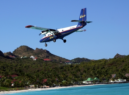 collectivity: ST  BARTS, FRENCH WEST INDIES - JANUARY 21 Dramatic Winair plane landing at St Barts airport on January 21, 2006  At 2,133 ft its runway is one of the shortest in the world