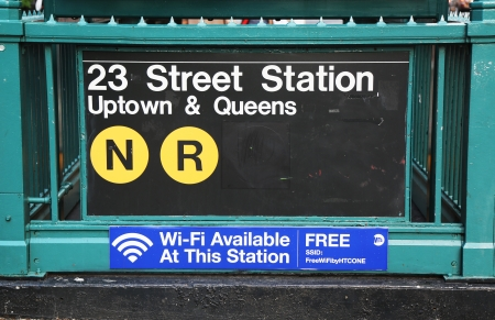 subway entrance: NEW YORK CITY - JULY 20  Subway entrance at 23rd Street in NYC on July 20, 2013  Station has free Wi-Fi available  Owned by the NYC Transit Authority, the subway system has 469 stations in operation