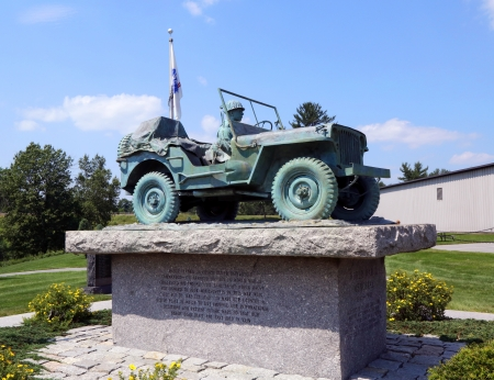 battleground: BANGOR, MAINE - JULY 4  Maine State World War II Memorial in Bangor, ME on July 4, 2013   It is an exact bronze casting of the Cole Land Transportation Museum WWII Willis Jeep