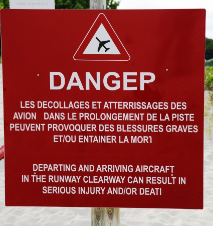 gustaf: Danger sign next to runway at St Barts  Gustaf III Airport, French West Indies Stock Photo