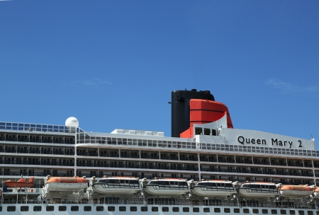 NEW YORK - AUGUST 15  Queen Mary 2 cruise ship detail at Brooklyn Cruise Terminal on August 15, 2013  Queen Mary 2 is Cunard s flagship ready for Transatlantic Crossing from New York to Southampton