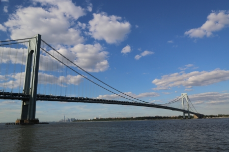 boroughs: NEW YORK CITY - AUGUST 15 Verrazano Bridge in New York on August 15, 2013 The Verrazano Bridge is a double-decked suspension bridge that connects the boroughs of Staten Island and Brooklyn in New York