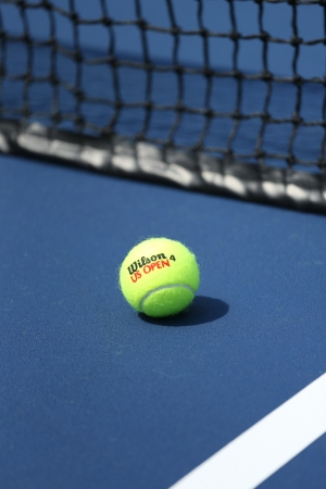 flushing: FLUSHING, NY - AUGUST 20  Wilson tennis ball on tennis court at Arthur Ashe Stadium  on August 20, 2013 in Flushing, NY  Wilson is  the Official Ball of the US Open since 1979 Editorial