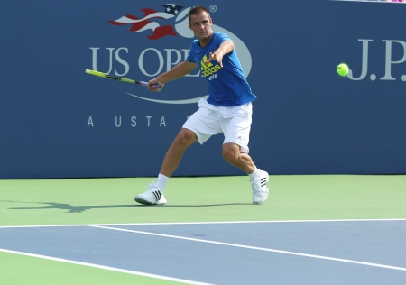 FLUSHING, NY - AUGUST 20  Professional tennis player Mikhail Youzhny practices for US Open 2013 at Louis Armstrong Stadium at Billie Jean King National Tennis Center on August 20, 2013 in Flushing, NY