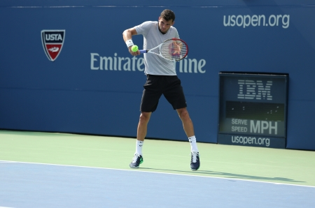 louis armstrong: FLUSHING, NY - AUGUST 20  Professional tennis player Grigor Dimitrov practices for US Open 2013 at Louis Armstrong Stadium at Billie Jean King National Tennis Center on August 20, 2013 in Flushing, NY