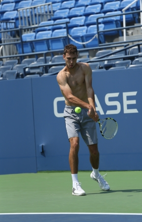 louis armstrong: FLUSHING, NY - AUGUST 20  Professional tennis player Jerzy Janowicz practices for US Open 2013 at Louis Armstrong Stadium at Billie Jean King National Tennis Center on August 20, 2013 in Flushing, NY