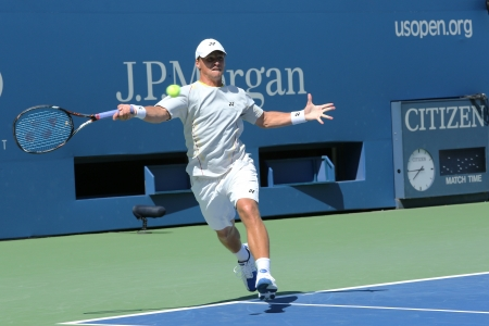FLUSHING, NY -AUGUST 24  Professional tennis player Ricardas Berankis from Lithuania practices for US Open 2013 at Billie Jean King National Tennis Center on August 24, 2013 in Flushing, NY